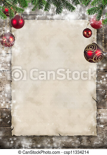Christmas theme with blank paper on wooden planks - csp11334214