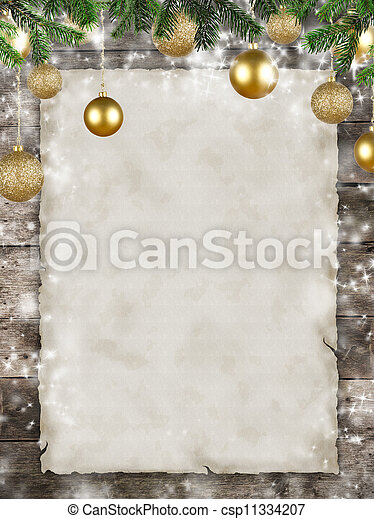 Christmas theme with blank paper on wooden planks - csp11334207