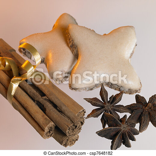 christmas theme with cinnamon sticks, stars and spice - csp7648182