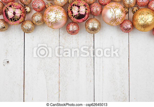 Christmas Top Border.Christmas Top Border Of Rose Gold And Golden Ornaments On White Wood