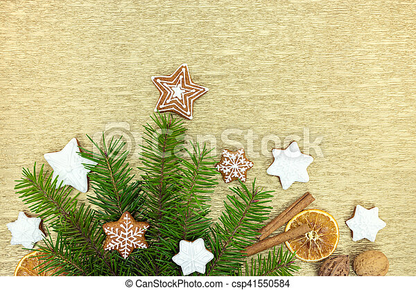 christmas traditional gingerbreads with cinnamon, nuts and orange slices with fir-tree branches - csp41550584
