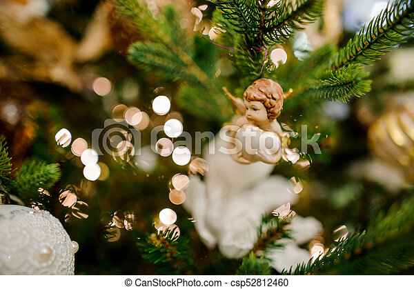 Christmas tree decoration toy in the form of a cute little angel - csp52812460