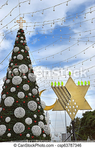 Islam Christmas.Christmas Tree Hanukkah Menorah And Crescent In Haifa Israel