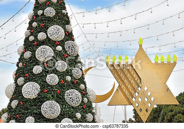 Christmas Hannakah.Christmas Tree Hanukkah Menorah And Crescent In Haifa Israel