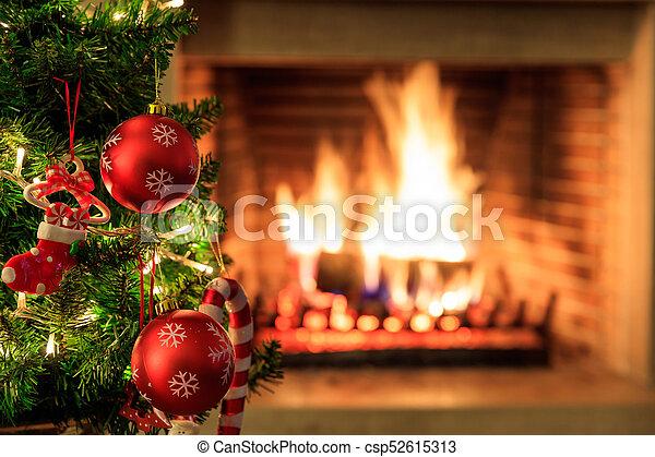 Burning Christmas Tree.Christmas Tree On Burning Fireplace Background