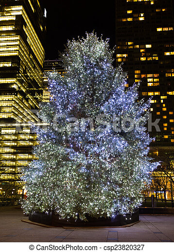 christmas tree outside with lights on csp23820327