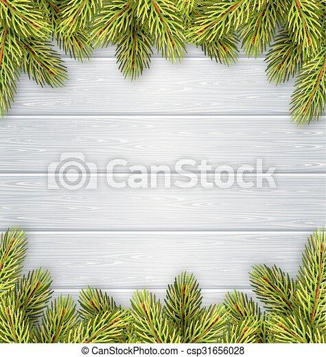 Christmas tree pine branches like frame on wooden desk. Christmas ...