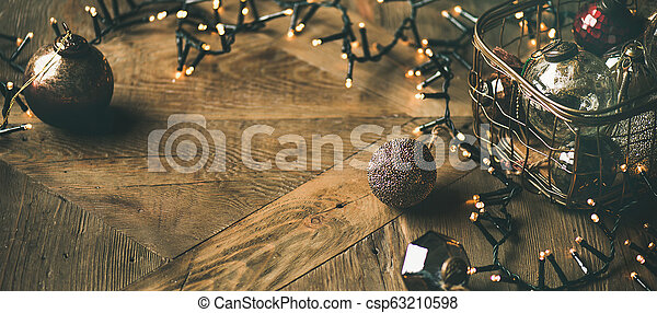 Christmas tree toy decoration balls and light garland, horizontal composition - csp63210598