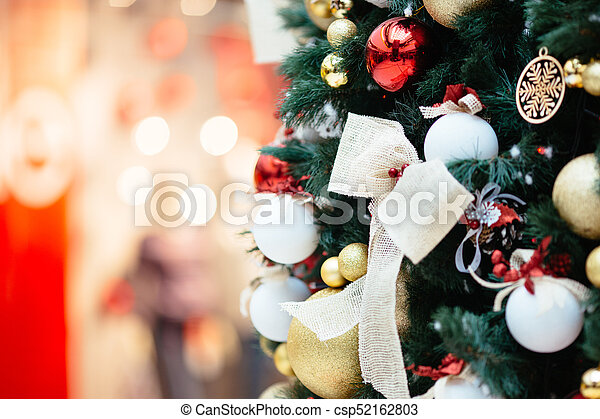 Christmas tree with christmas ornaments - csp52162803