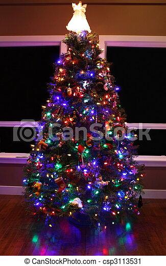 Christmas Tree With Glowing Lights Lit Angel On Top