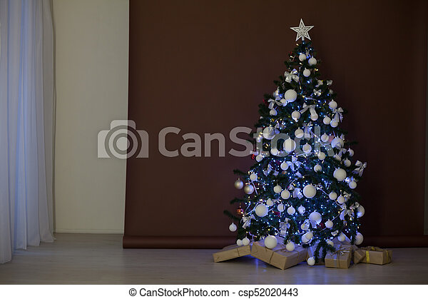 Christmas Tree With Lights Garland Gifts At Brown White Background 1