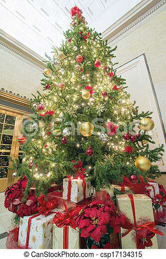 christmas tree with presents tall perspective csp17134315