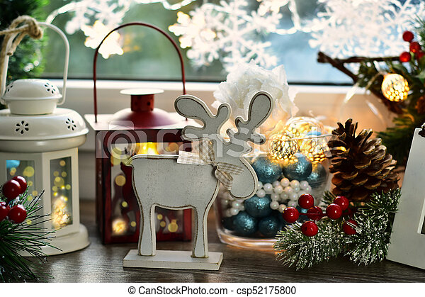 christmas window decoration with wooden reindeer and old lanterns csp52175800 - Wooden Deer Christmas Decorations