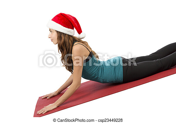 christmas yogi woman in cobra pose during yoga yoga woman