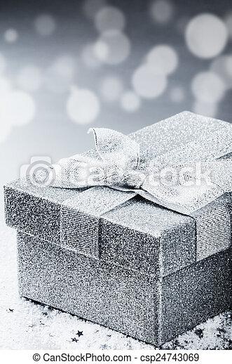 Chrstmas present in silver shiny box - csp24743069