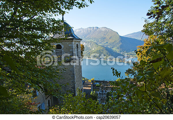Church and Annecy lake in Savoy, France - csp20639057