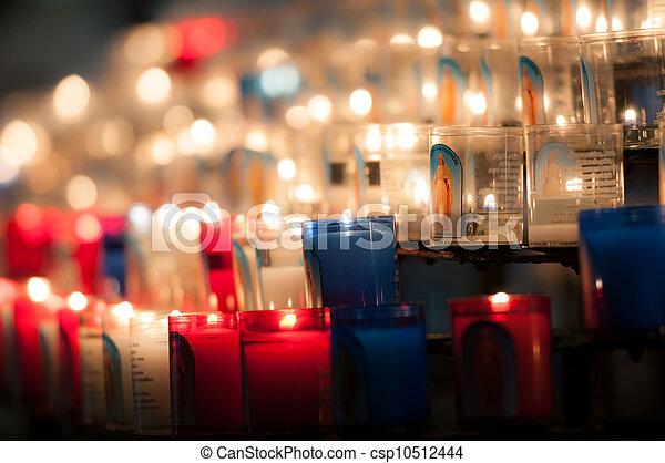 church candles in dark - csp10512444