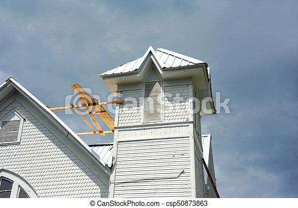 Church gets metal roof - csp50873863