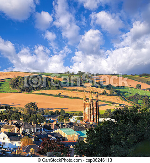 Church in Totnes against countryside in England, UK - csp36246113