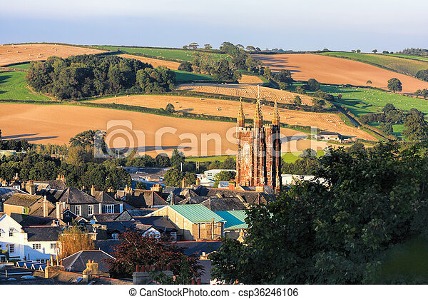 Church in Totnes against countryside in England, UK - csp36246106