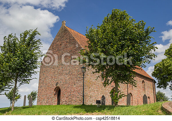 Church on a hilltop in Ezinge - csp42518814