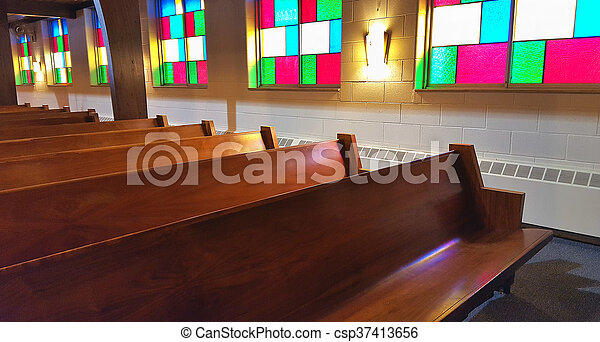 church pews with stained glass - csp37413656