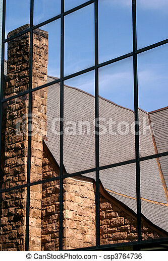 Church reflection in a glass window - csp3764736