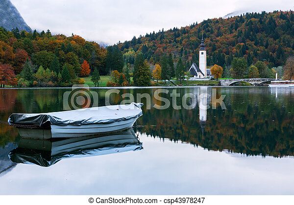 Church tower and stone bridge at Lake Bohinj - csp43978247