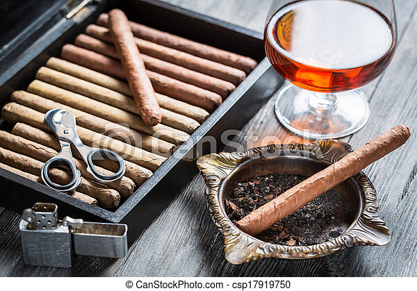 Cigar in ashtray, lighter and cognac - csp17919750