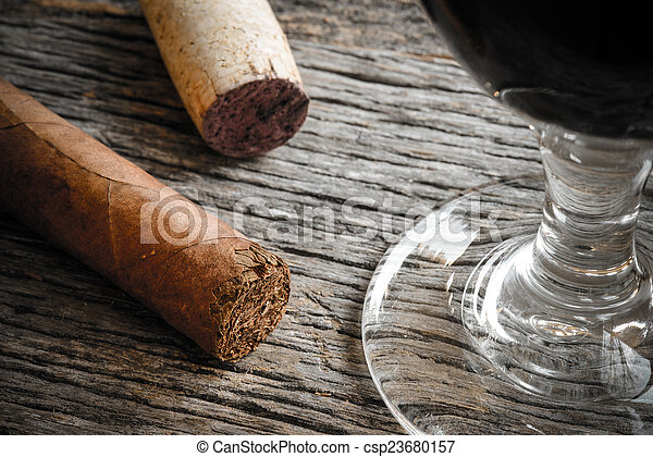 Cigar with Glass of red wine on Wooden Background - csp23680157