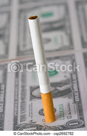 cigarette laying on money - csp2692782