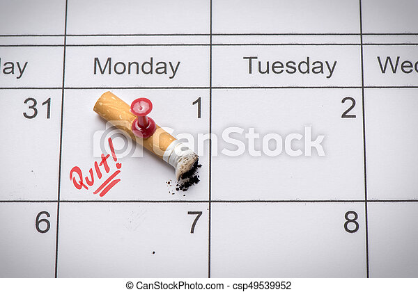 Cigarette on calendar. Time to quit smoking concept - csp49539952