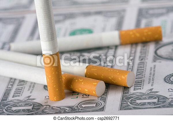 cigarettes laying on money - csp2692771