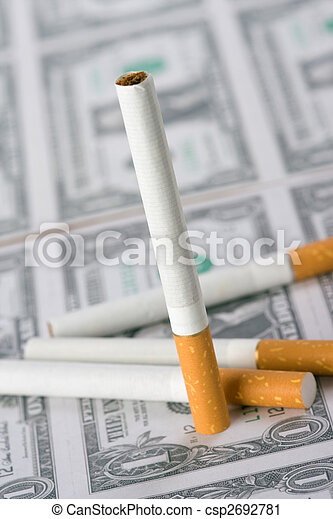 cigarettes laying on money - csp2692781