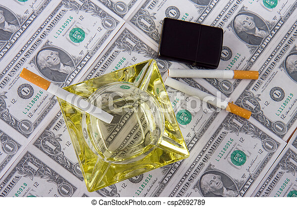 cigarettes laying on money - csp2692789