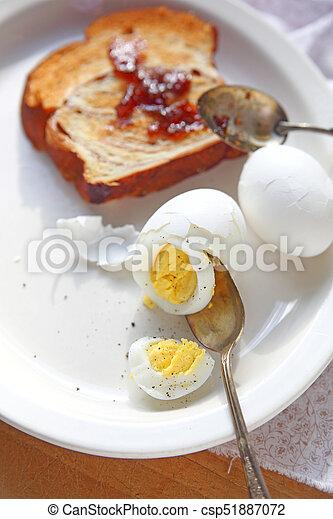 Cinnamon bread toast and boiled eggs - csp51887072