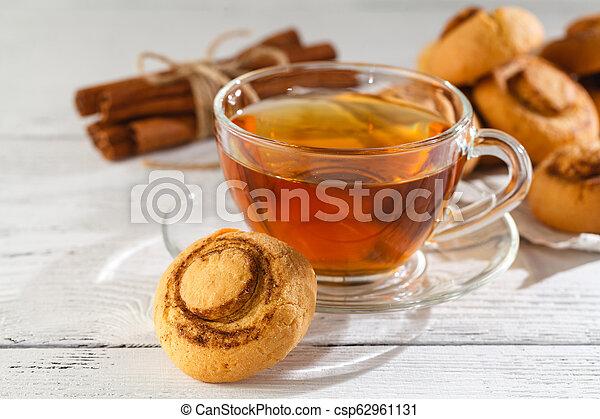 Cinnamon cookies with tea - csp62961131
