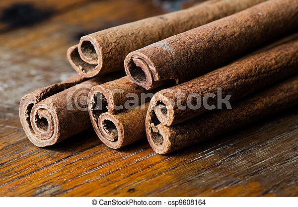 Cinnamon on table - csp9608164