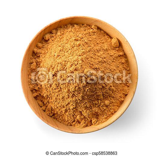 Cinnamon Powder in wood spoon on white background - csp58538863