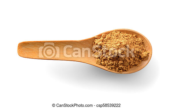 Cinnamon powder in wood spoon on white background - csp58539222
