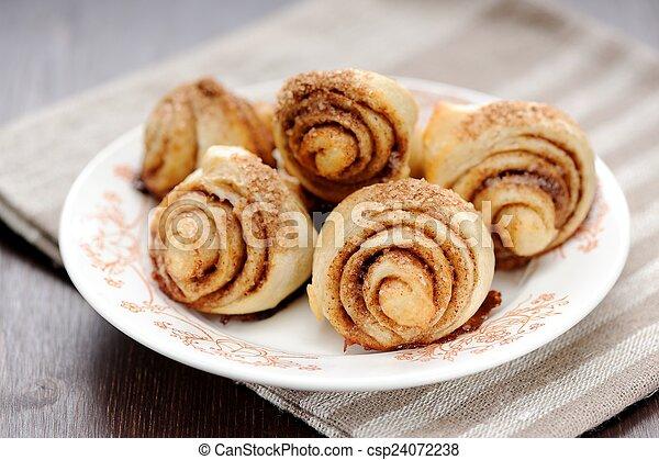 Cinnamon rolls on white plate - csp24072238