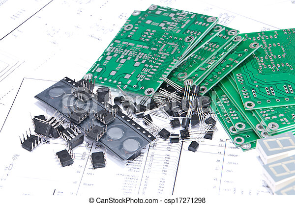 Circuit boards and components with schematics in background. Circuit ...