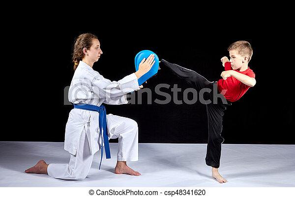 Circular kick kicking boy is beating on the simulator - csp48341620