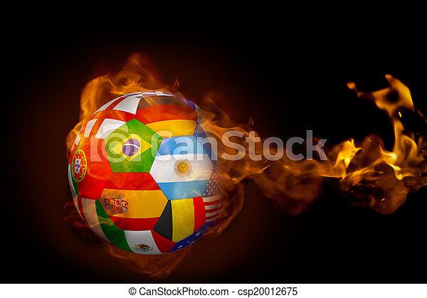 Imagen compuesta de fuego que rodea el fútbol internacional de banderas - csp20012675