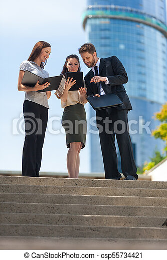 City Business Man Woman Team Using Tablet Computer - csp55734421