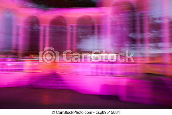City lights in motion at night as abstract background. - csp89515884