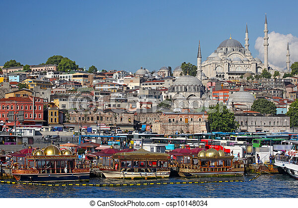 City of Istanbul in Turkey, Eminonu district, on the left New Mosque (Turkish: Yeni Valide Camii)  - csp10148034