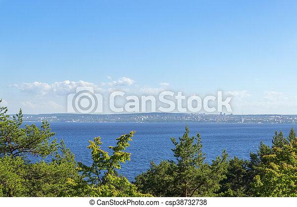 City on coastline of lake bay - csp38732738