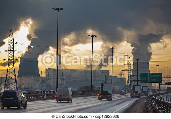 City ringway with cars and air pollution from heat electric generation plant  - csp12923626