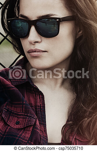 city woman portrait with sunglasses outdoor - csp75035710